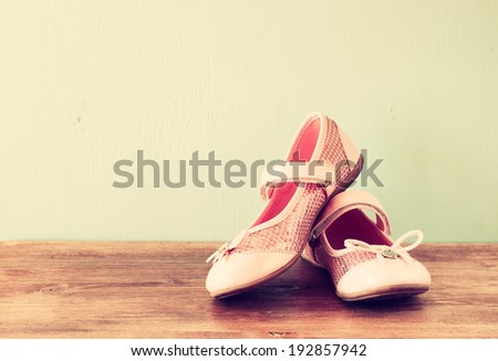 girl shoes over wooden deck floor. filtered image - stock photo