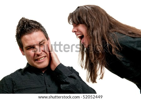 Girl shouting in guy's ear isolated on white background - stock photo