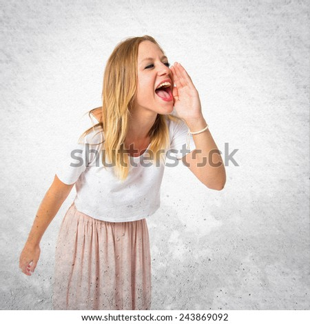 Girl shouting over textured background