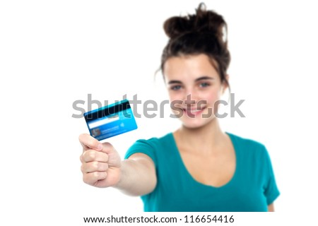 Girl showing her cash card, arm stretched out. Focus on card - stock photo