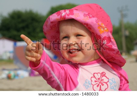 girl showing something nice - stock photo