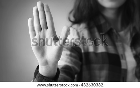 Girl showing stop hand sign gesture (Body language, gestures, psychology) - stock photo