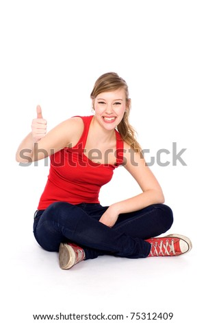 Girl showing thumbs up - stock photo