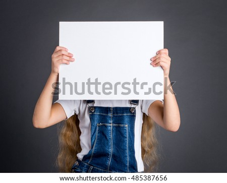 Girl showing white blank poster