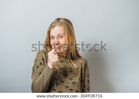 Girl Shows fig - stock photo