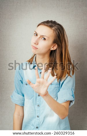 girl shows hands stop - stock photo