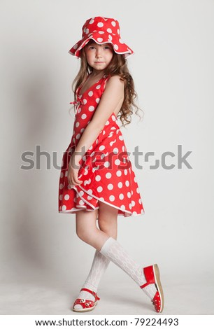 girl shows her red dress in a pea - stock photo