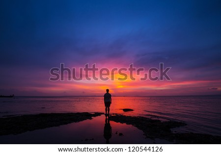 girl silhouette at sunset - stock photo