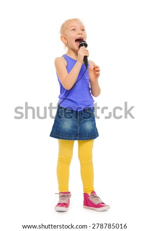 Girl singing karaoke in microphone and standing - stock photo