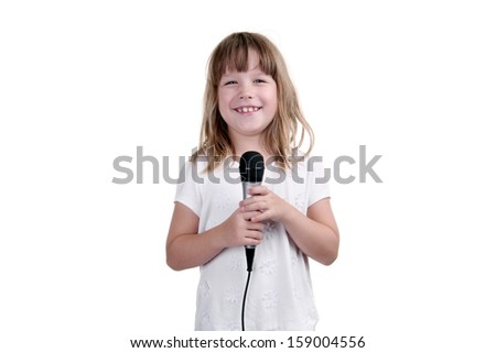 Girl sings with a microphone in hands on a white background - stock photo