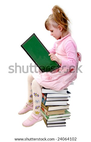 girl sit on the heap of book and read the big book