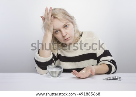 girl sits table going drink tablets stock photo royalty free