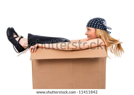 Girl sitting in a cardboard box, copy space, isolated on white. - stock photo