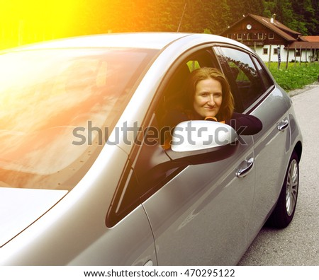 girl sitting in the car and looking at the camera
