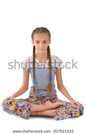 Girl sitting in the lotus position on the white background - stock photo