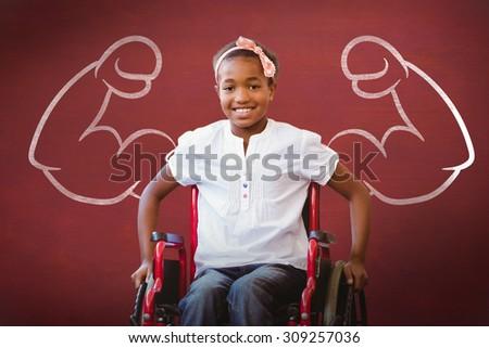 Girl sitting in wheelchair in school corridor against desk - stock photo