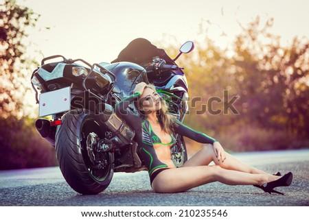 girl sitting near bike, body art - stock photo