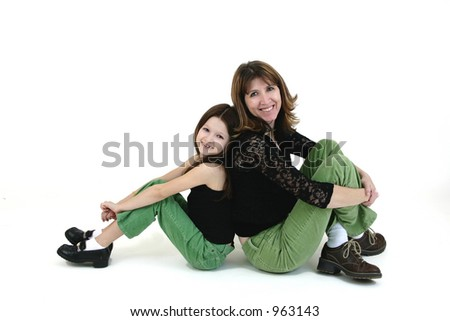 Girl sitting next to mother