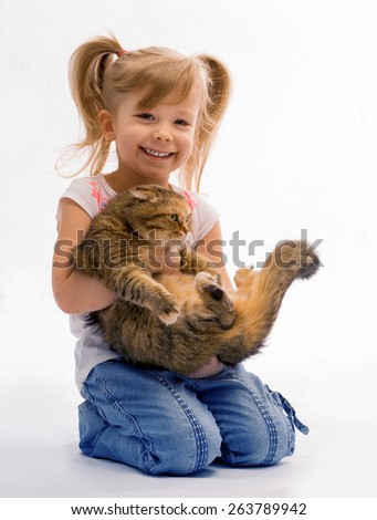 Girl sitting on his lap with his beloved cat  - stock photo