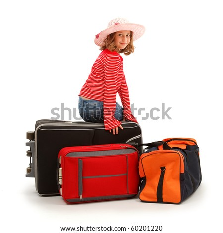 Girl sitting on luggages, ready to trip - stock photo