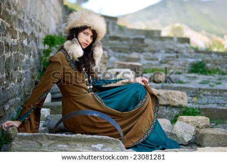 Girl sitting on the barrel (historical performance)