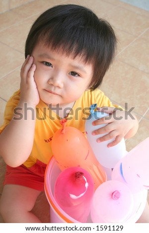 girl sitting on the floor with balloons - stock photo