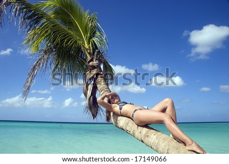 Girl sitting on the palm - stock photo