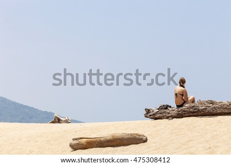 girl sitting relaxing on the beach in summer day