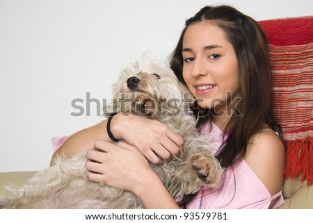 girl sitting with her dog in her arms