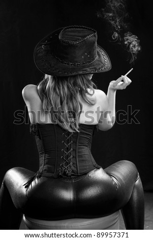 girl sitting with his back and cigarette