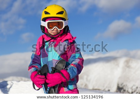 Girl ski on the mountain - stock photo