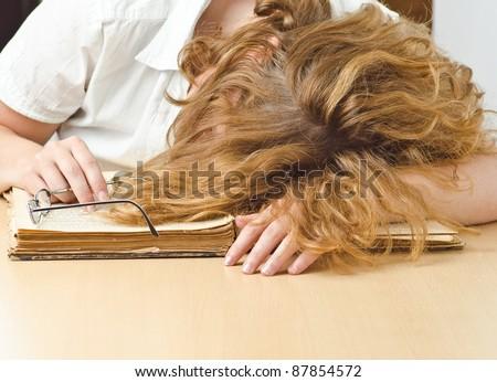 girl sleep of her old books - stock photo