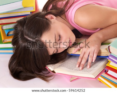Girl sleep on pile of book. Education.