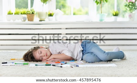 girl sleeping during art class