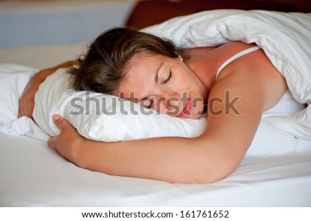 girl sleeping in a comfortable position on the stomach - stock photo