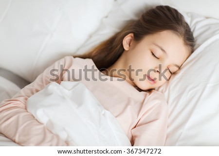 girl sleeping in bed at home - stock photo