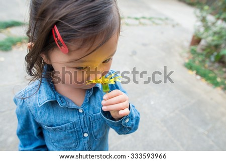 Girl smell the scent of flowers - stock photo