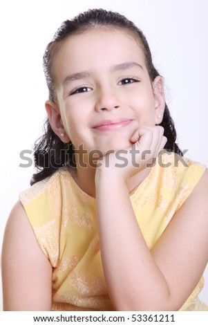 Girl smiling and looking at the camera isolated on white - stock photo