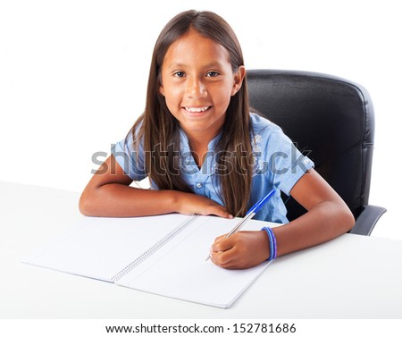 girl smiling doing homework on a white background