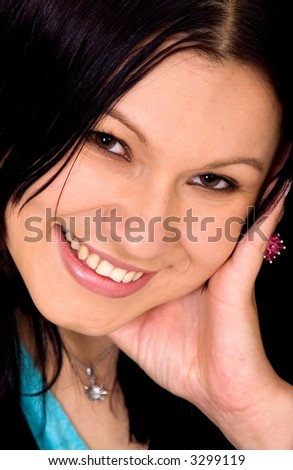 girl smiling in a portrait with her hand on her face