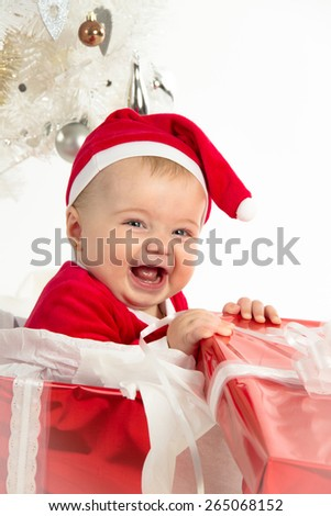 Girl smiling inside a christmas present box - stock photo