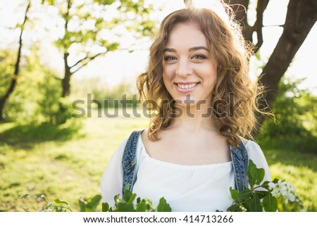 girl smiling portrait, girl with wavy hair, girl boho style - stock photo