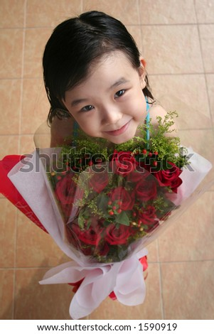 girl smiling, standing & holding bouquet of red roses - stock photo