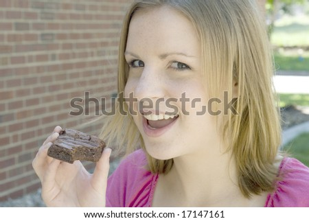 Girl smiling while holding a brownie