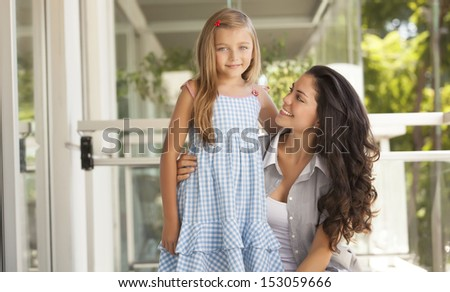girl smiling with her mother - stock photo