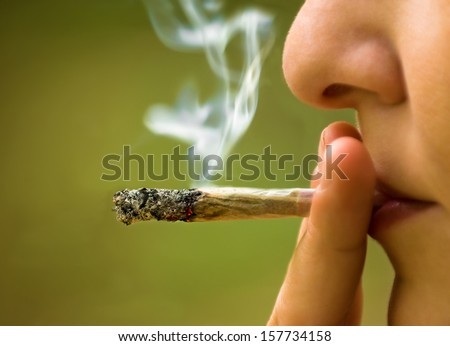 girl smoking marijuana close up