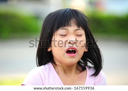 Girl sneezing - stock photo