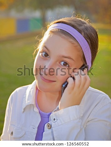 Girl Speaking On Cell Phone At sunset light