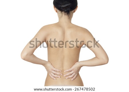 girl standing and massaging sore back