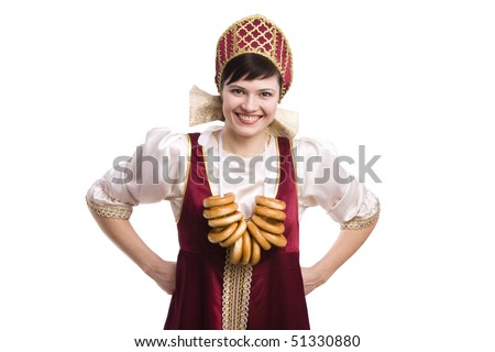 Girl standing in Russian traditional costume with bread-ring. Woman is wearing sarafan and kokoshnik . The girl in red old russian dress. Isolated on white. - stock photo
